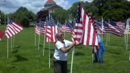 Charlestown (MD) Residents setting up display of Memorial Day flags
