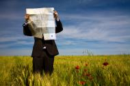 Man looking at a map in an open field