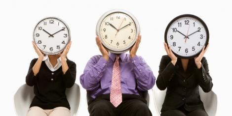 3 business people with clocks as faces - time contraints